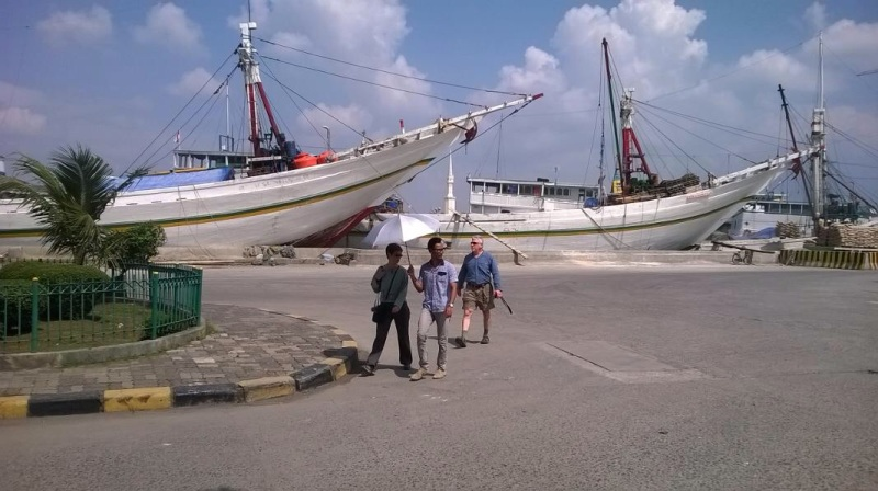 Leaving Sunda Kelapa port with huge Phinisi ships at the back