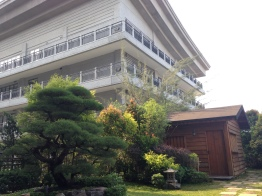 The modern building and the ancient building where master Tzu Chi started helping people.