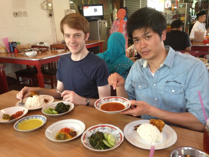 Tim and Shouta trying spicy Padang food
