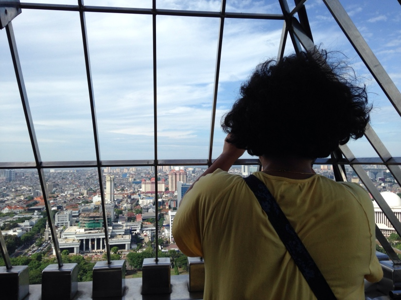 The sky was so clear that Dipti kept taking pictures of Jakarta's skyline with enthusiasm.