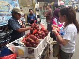 """Joanie from The Phillippines was thrilled to see """"duku"""" on the street and couldn't help herself buying 1kg. """"I haven't eaten those for 10 years!!!"""""""