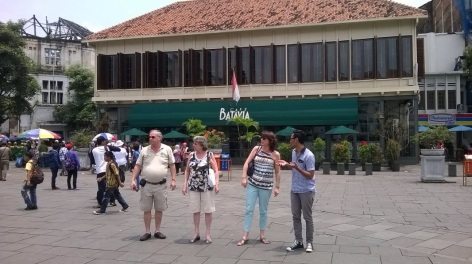 Walking in front of the most famous cafe in the square, Cafe Batavia.