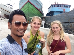 Farid with Tiana and Amelia from England in the oldest port in Jakarta. You can see the giant wooden boats behind us!