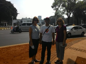 Our guide, Candha, with our participants, Susan and Lindy, in front of the presidential palace.