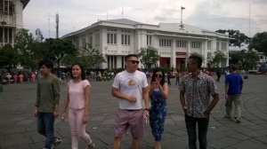 Our guide with a Malaysian family wandering around the old town of Jakarta