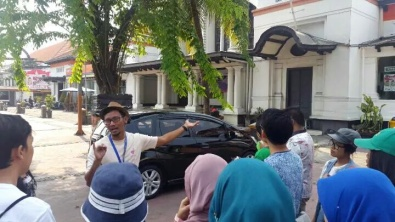 The guide is explaining about the Philately Building.