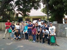 Jakarta Walking Tour participants in front of Indonesia's former president, Suharto.