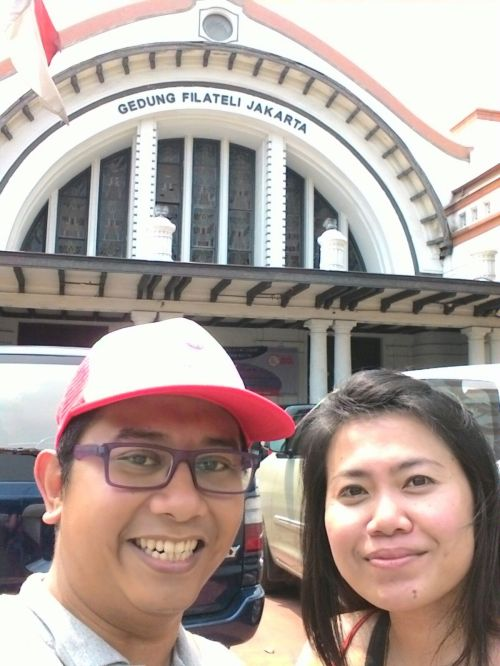 Our guide, Candha, with Florence from Malaysia in front of an old post office in Pasar Baru.